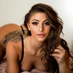 sexy young girl on bed tattoos