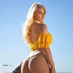 yellow top blonde haired girl outdoors