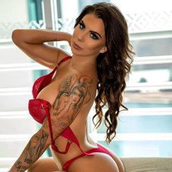 stunning brunette female stripper in sexy red lingerie
