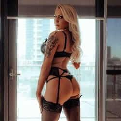 long haired blonde model looking over shoulder