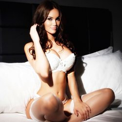 dreamy girl on bed white lingerie